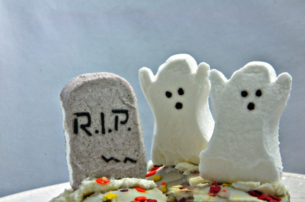 image of ghost cup cakes for post on coffee shop halloween serving suggestions